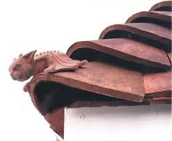 terracotta bat hip tile this fella clay finials