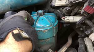 how to change fuel filter on a 2005 international dt466 youtube