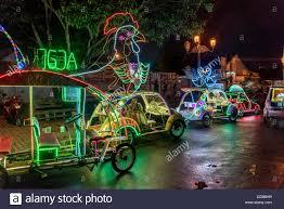 colorful lit bicycle cars on alun alun square yogyakarta java