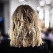 short layered medium length hairstyles tousled sunflower blonde shoulder length hair with choppy layers