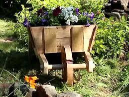 Wooden Wheelbarrow Planter by Diy Wooden Wheelbarrow Planter Ebay