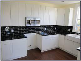Black Glass Tiles For Kitchen Backsplashes by Photos Hgtv Fireplace With White Mosaic Tile Surround Idolza