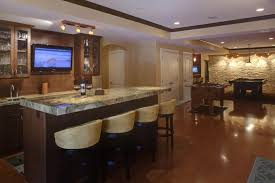 curved small basement bar design ideas with black iron backrest