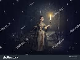 beautiful woman candle medieval dress on stock photo 319465793