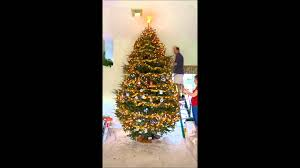 12 foot christmas tree decorated in 12 hours shown in less than 12