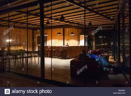 Illuminated Reception Desk Empty Hotel Reception Desk At Night And People Sitting At Sofa
