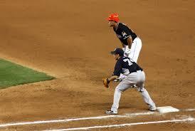 first baseman tips knock the ball down