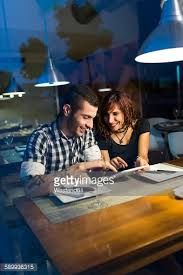 young couple in modern restaurant having dinner stock photo