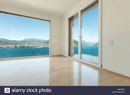 empty room pictures modern house empty room with window overlooking the lake stock