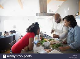 african american family cooking in kitchen stock photo royalty