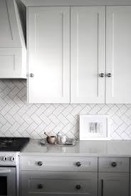 white ceramic subway tile herringbone pattern subway tiles and