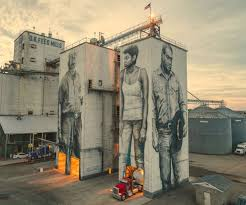 art festival blankets fort smith in rainbow paint and recycled guido van helten s massive mural on the exterior of ok feed mills