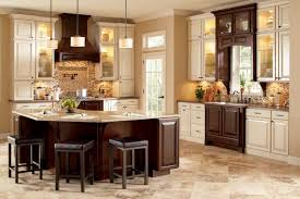 antique beige kitchen cabinets traditional kitchen backsplash using small tiles in neutral colors