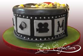 movie reels cake with popcorn tickets and clapboard emi ponce
