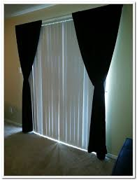 hang curtains over vertical blinds curtain curtain image