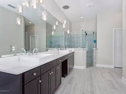 master bathroom with flat panel cabinets u0026 pendant light in