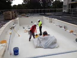 Enhance the beauty of your pool with a pool tile repair using