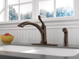 delta linden single handle deck mounted kitchen faucet with spray