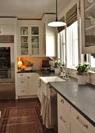 white kitchen cabinets with slate countertops skirted kitchen sink cottage kitchen benjamin