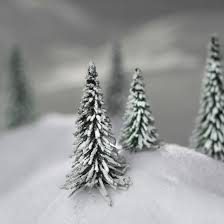 miniature flocked and frosted artificial pine trees