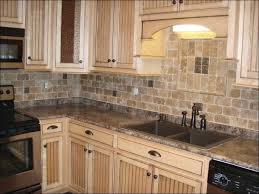 kitchen grey floors and white cabinets dark grey backsplash grey