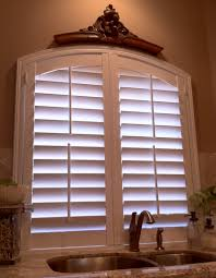 Kitchen Windows Design by Interior Arched Windows With Brown Graber Shutters Also Brass