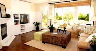 brown leather living room living room with fireplace and tv on