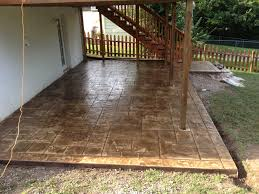 stamped concrete patio under deck timmermann concrete