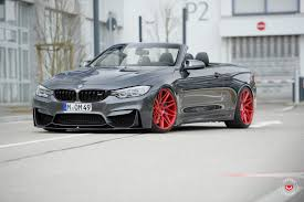 red bmw m4 bmw m4 convertible slides into red heels