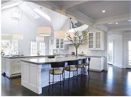 kitchen white backsplash white granite countertop classic wood cabinet metallic