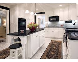 glass countertops white kitchen black cabinet table island
