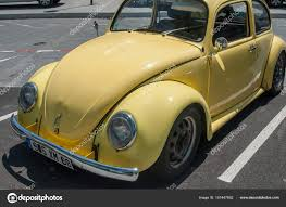 yellow volkswagen beetle royalty free old volkswagen yellow beetle parked in the street u2013 stock