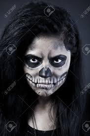 young woman in day of the dead mask skull face art halloween