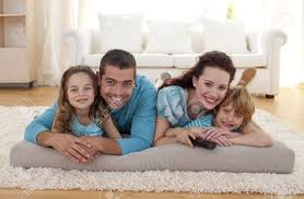 Smiling Family On Floor In Livingroom Stock Photo Picture And - Family in living room