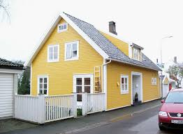51 stock photo yellow mustard house with white trim and spring