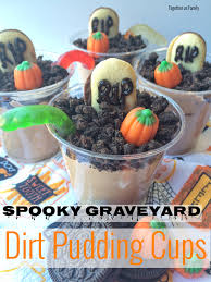 spooky graveyard dirt pudding cups together as family