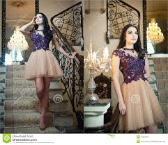 beautiful long hair in colored dress posing in a vintage