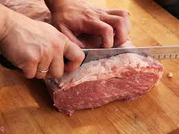knife skills how to cut a whole beef strip loin into steaks step six cut steaks