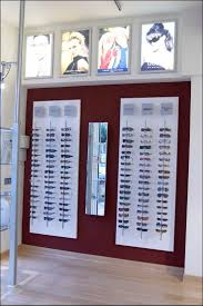 177 best opticians displays and shop layouts images on pinterest optical shop in malaga spain like the color block behind display