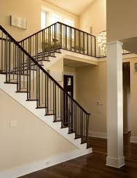 rod iron railing staircase craftsman with ceiling lighting