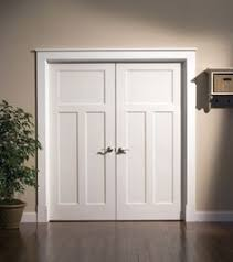 white interior doors with glass white trim with hickory brown doors and oil rubbed bronze knobs