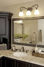 houston kraftmaid vanity bathroom traditional with wall lighting