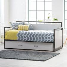 white and grey wooden daybed with white drawers and striped grey