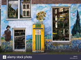 the exterior of a coffee house in amsterdam with murals and window stock photo the exterior of a coffee house in amsterdam with murals and window reflections of typical dutch themes