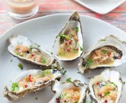 comment cuisiner des huitres huîtres chaudes sauce acidulée recette de huîtres chaudes sauce