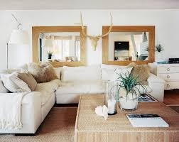 interior white floor lamp 2 beige framed wall mirror brown