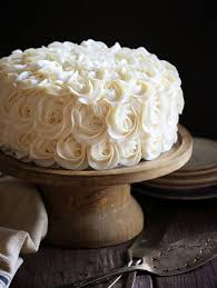white layer cake with fudgy brownie and decorators buttercream i