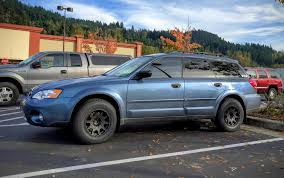 rally subaru wagon who s running 15 wheels and beefier tires need to see pics