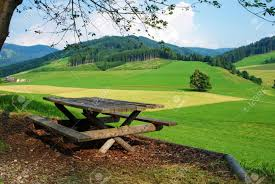 Wooden Bench And Table Summer Landscape With Hills And Meadows Wooden Bench And Table