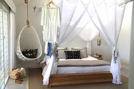 exotic bedroom interior with canopy bed beside white knitted diy exotic bedroom interior with canopy bed beside white knitted diy hanging chair